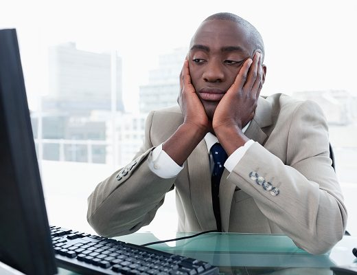 Bored businessman looking at his computer