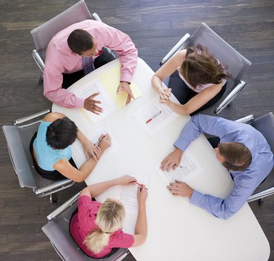 Five businesspeople at boardroom table